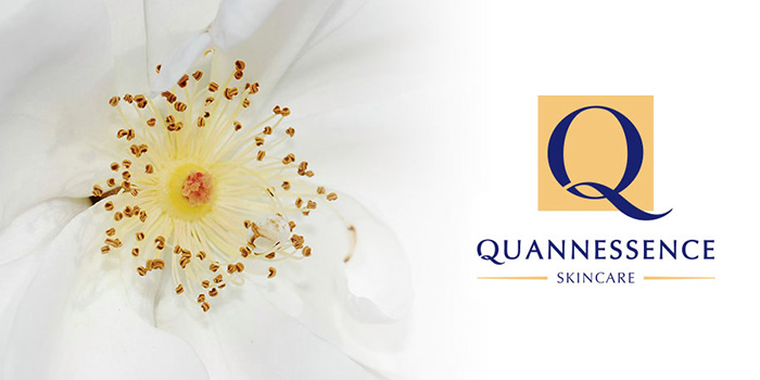 Quannessence Skincare logo and flower